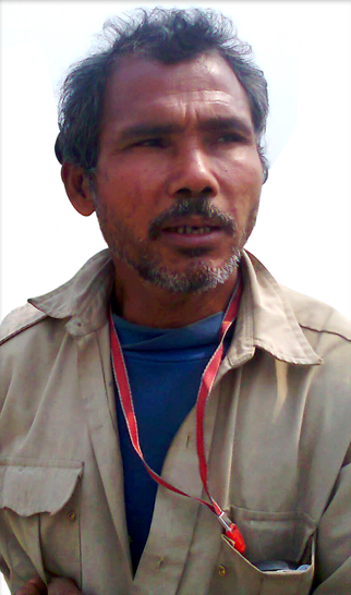 Distractedly Jadav 'Molai' Payeng poses for a photo wondering if his cousin has managed to jailbreak his new iPhone (Photo: Wikipedia)