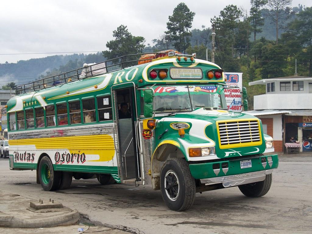 A Chicken Bus at Quatro Caminos in Guatemala (Source: Flickr/Laurent de Walick)