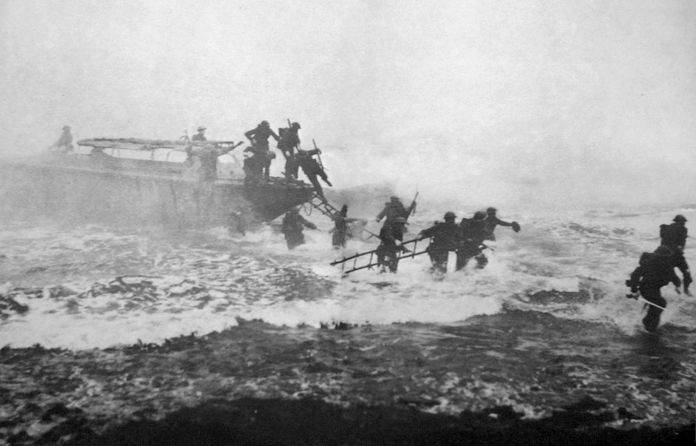 Mad Jack Churchill (far right) leads a training exercise, sword in hand, from a Eureka boat in Inveraray, Scotland. (Photo: Wikimedia/War Office)