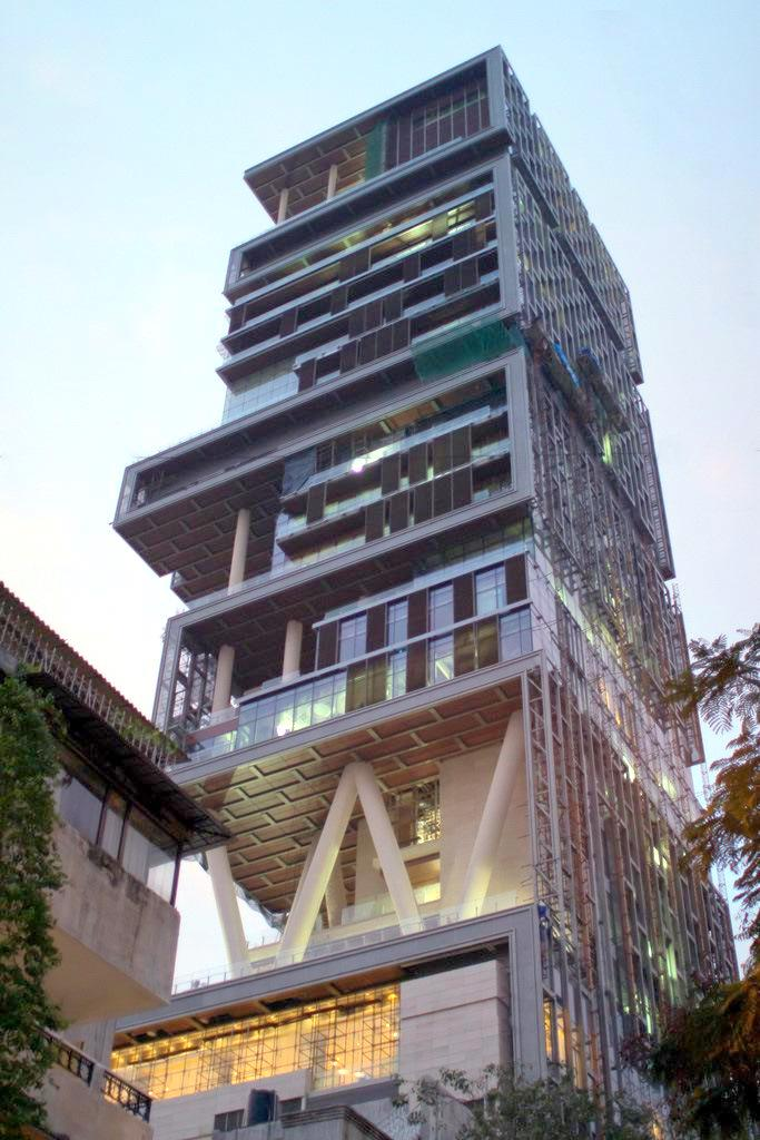 Antilia, in Mumbai, is the sprawling residence of Indian billionaire Mukesh Ambani. Antilia is 173 metres high, featuring, three helipads, a 168-car garage, a ballroom, 80-seat theater, terrace gardens, spa, and a temple. (Photo: Wikimedia/Jhariani)