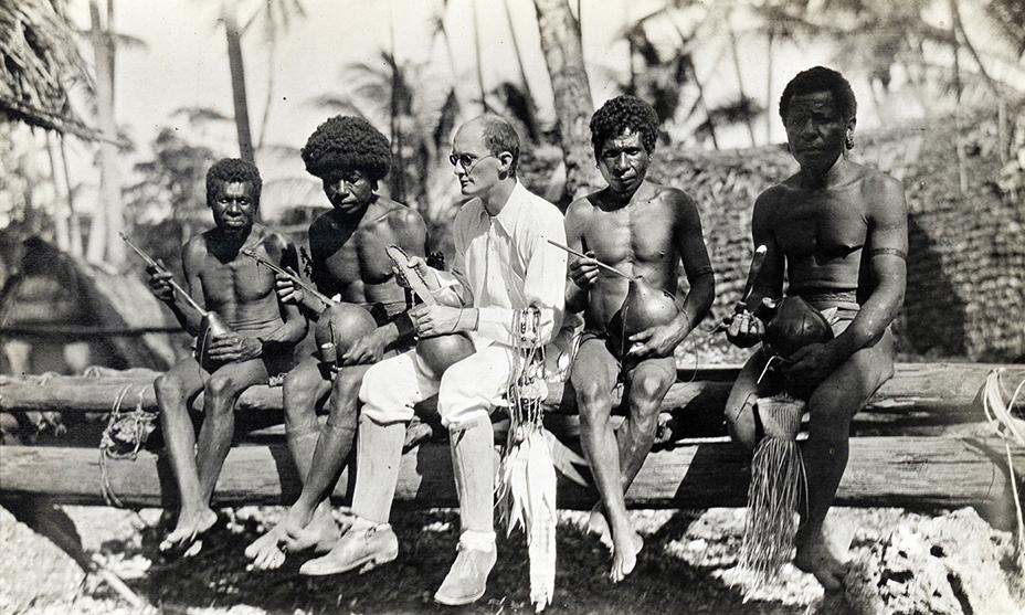 Polish anthropologist Bronislaw Malinowski with Trobriand Islanders of Melanesia, 1918 (Photo: Wikimedia Commons/London School of Economics Library Collections).
