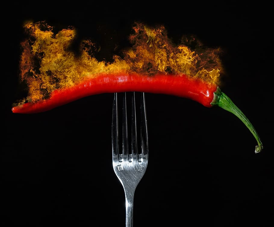 Chili pepper on fire. (Photo: WallpaperFlare)