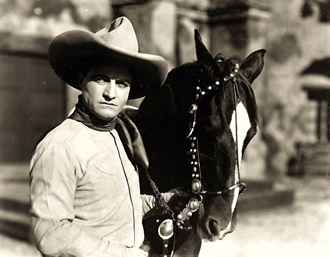 Tom Mix was an American film actor who starred in early Western movies between 1909 and 1935. The ten gallon hat was Tom Mix's trademark. Mix would even help an unemployed John Wayne find work shifting props at Fox Studios, helping Wayne launch his Hollywood career. (Photo: Flickr/Breve Storia del Cinema)