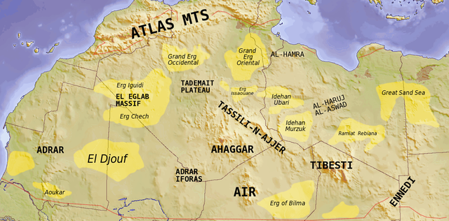 Map showing major Dune seas (ergs) and Mountain ranges of the Sahara. Red dashed line shows approximate limit of the Sahara. National borders in grey. Dune seas in yellow. (Image: Wikipedia/TL Miles)