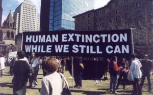 """""""Human extinction while we still can"""" sign at protest. (Photo: The Church of Euthanasia website)"""