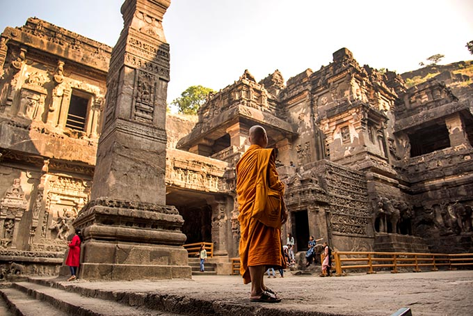 Aurangabad, Maharashtra, India, 27 November 2019 : Buddhist monk visit to the Kailasa Temple, Ellora caves, It is one of the largest rock-cut cave in the world and UNESCO world heritage site. (Photo: Shutterstock)