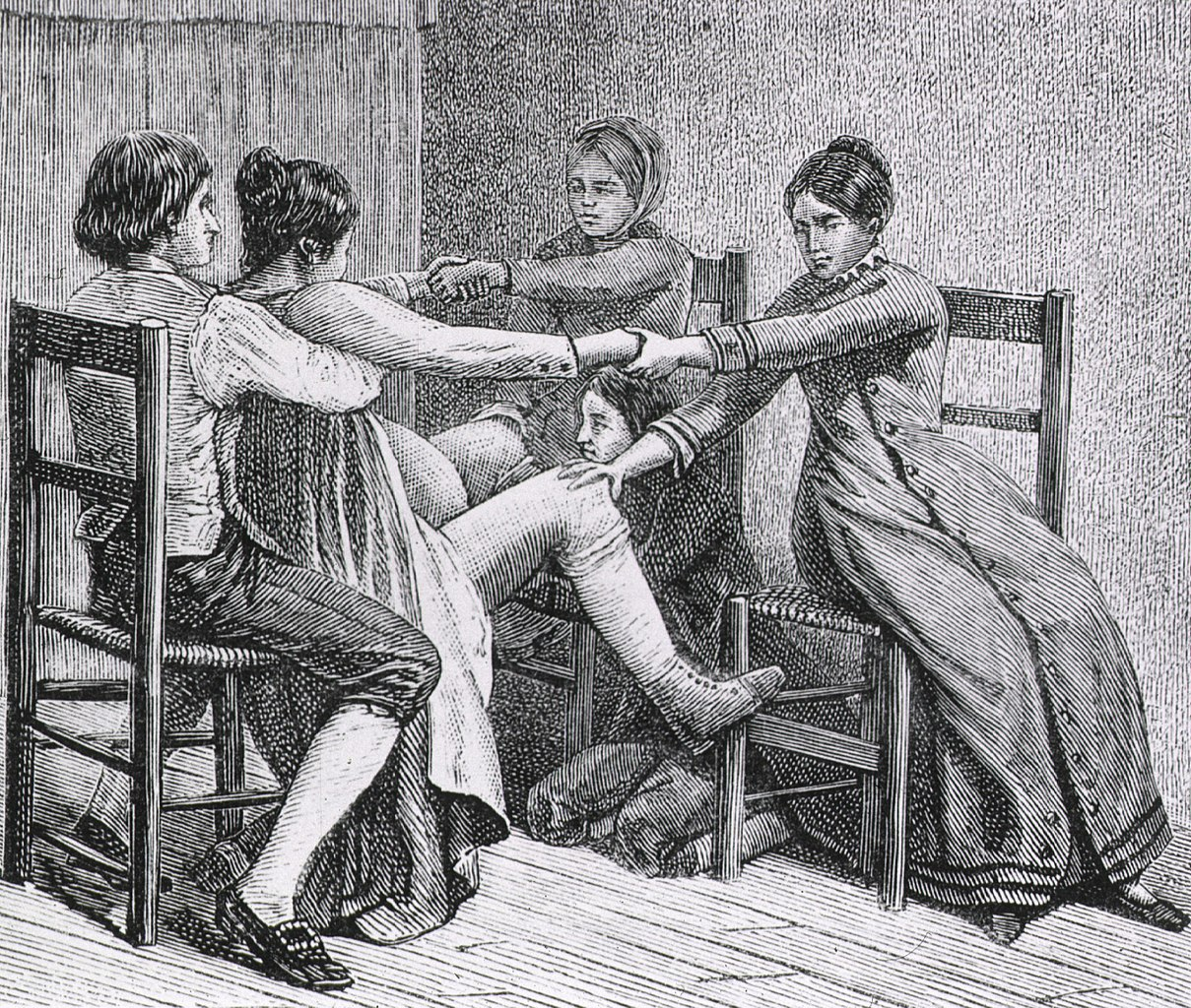 Two women and two men assist during childbirth. (Image: Wikimedia/National Library of Medicine/Gustave Joseph Witkowski)