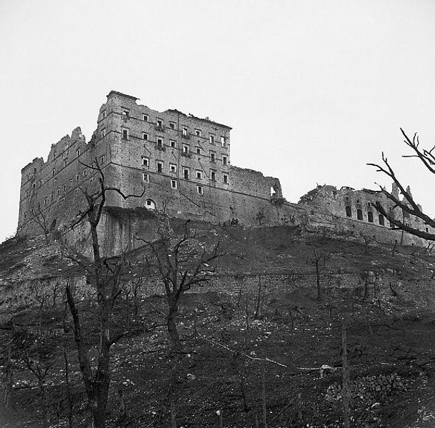 The ruined monastery at Cassino, Italy, 19 May 1944. Ruined shell of the Monte Cassino Monastery a day after it was captured by the 2nd Polish Corps troops. Photograph shows the only surviving wall of the Abbey after the bombardment in February 1944. (Wikimedia/McConville (Sgt), No 2 Army Film & Photographic Unit/Imperial War Museum)