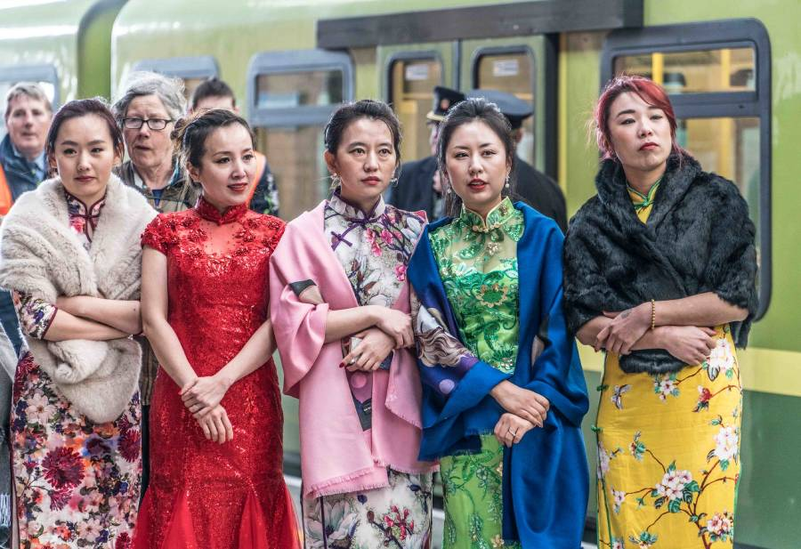 The China Cheongsam Association of Ireland perform traditional Chinese music and dance on platform four of Connolly Station in Dublin, February 2016. (Photo: Flickr/William Murphy)